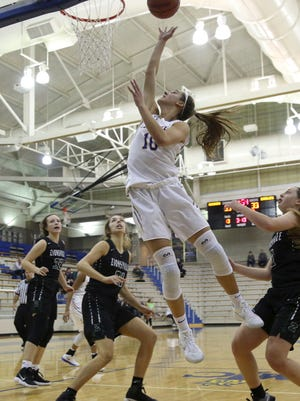 Amy Dilk of Carmel reached the 1,000-point barrier in her career in the Greyhounds' victory over Zionsville.