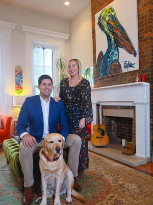 Mo McKnight Howe and Scott Howe own a 2-bed, 2-bath home in Butchertown. They're pictured here with their dog, Major.