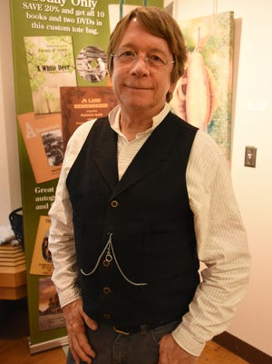 "Patrick Smith Jr., son of author Patrick Smith, dresses for the part. Nearly 100 people came out to the Rookery Bay Environmental Learning Center on Tuesday, Nov. 21 for a presentation on ""A Land Remembered,"" a beloved book on Florida history."