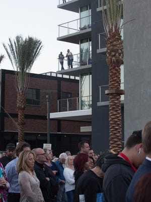Guests of the Rowan Hotel look onto the Palm Springs downtown project ribbon cutting ceremony, Thursday, December 14, 2017.