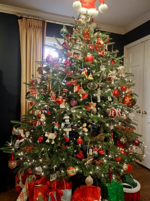 A Christmas tree in the den at the home of Laura Horsey in Louisville, KY. Dec. 7, 2017