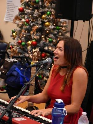 Sarah Hadeka entertains for the senior citizens at the Golden Gate Senior Center Christmas party.