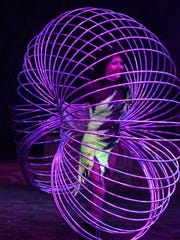 A performer dazzles with hula hoops. Cirque Ma'Ceo, a family-friendly show featuring acrobatic horse riding, fire dancing, gymnastics and humor, played Thursday through Sunday afternoon at the Collier County Fairgrounds.