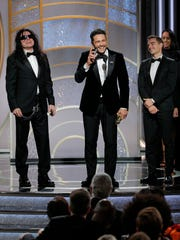 James Franco, with Tommy Wiseau and Dave Franco, accepts the award for Best Performance by an Actor in a Motion Picture  Musical or Comedy for  The Disaster Artist during the 75th Annual Golden Globe Awards at The Beverly Hilton Hotel on Jan. 7, 2018 in Beverly Hills, California.