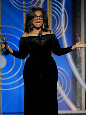 Oprah Winfrey accepts the Cecil B. Demille Award at the Golden Globes.