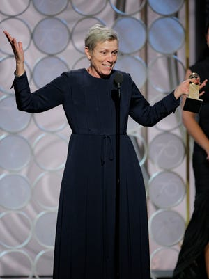 'Three Billboards' star Frances McDormand accepts her Golden Globe for best actress in a drama.