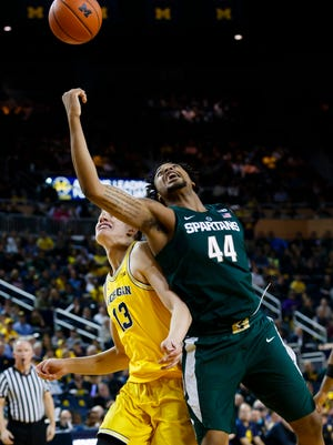 Michigan State Spartans forward Nick Ward (44) go for the ball defended by Michigan Wolverines forward Moritz Wagner (13) during last year's game at Crisler Center.