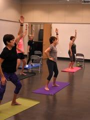 Essentrics participants go through a routine. Essentrics