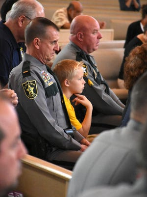 Sheriff's Lt. Gary Martin, left, was one of many from the Collier County Sheriff's Office attending the service.
