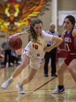 Chaparral's Jess Finney drives to the basket against Arcadia on Tuesday, Feb. 6, 2018 at Chaparral High School in Scottsdale, Ariz. Chaparral won, 54-53.