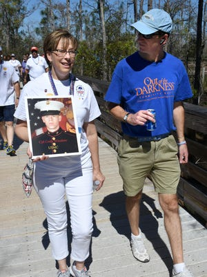 Chaplain Kim Hayes, of American Gold Star Mothers, walks in honor of Marine Cpl. Cody Winslow, alongside an unidentified walker. The Southwest Florida chapter of the American Foundation for Suicide Prevention held its second Walk to Fight Suicide at North Collier Regional Park on Sunday, Feb. 18, 2018, with over 300 participants.
