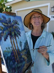 File: Jo-Ann Sanborn paints in her own front yard.