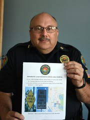 MIPD Capt. Dave Baer with the police dept. flyer announcing the closing. Yellowbird Street has been restricted to vehicles under 10,000 lbs., apart from fire/EMS, garbage trucks, school buses or trucks making deliveries on the street.