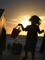Landon Pruitt of Fort Myers, 3, hits the Naples beach