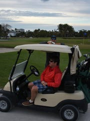 Golfers finish up their round at the Naples Beach Hotel