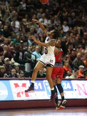 Mississippi State's Jazzmun Holmes (10) breaks up a