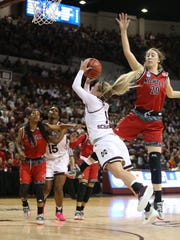 Mississippi State's Blair Schaefer (1) is fouled as she drives to the basket in the first half. Mississippi State played Nicholls in the first round of the NCAA Women's basketball tournament at Humphrey Coliseum on Saturday, March 17, 2018. Photo by Keith Warren
