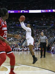 Mississippi State's Roshunda Johnson (11) hits a three-point basket to tie the game in the final seconds. Mississippi State played Louisville in the semifinal round of the NCAA Women's Basketball Tournament in Columbus, Ohio, on Friday, March 30, 2018. Photo by Keith Warren