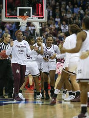 MSU players congratulate Mississippi State's Roshunda Johnson (11) as the game goes into overtime. Mississippi State played Louisville in the semifinal round of the NCAA Women's Basketball Tournament in Columbus, Ohio, on Friday, March 30, 2018. Photo by Keith Warren