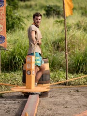 "Michael Yerger competes in a challenge on ""Survivor:"
