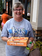 """Charlotte DeCastro said she's not a basketball fan, """"but my boyfriend is."""" Little Caesar's pizza parlors made good on a March Madness bet on Monday, giving away free pizza to all comers at lunchtime."""