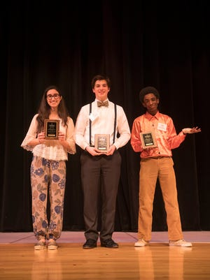 2018 Delaware Poetry Out Loud runner-up Dounya Ramadan, left; state champion Sam McGarvey center; and Richard Matthews, third place winner.
