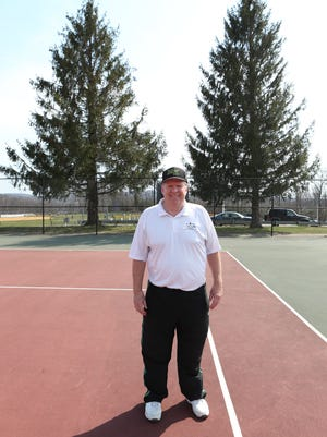 When Dan Benz began coaching tennis at Morris Knolls in 1977, he was taller than the trees in this photo.