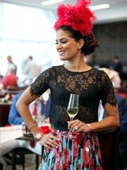 Asha Elias, from Miami, Florida, coordinated her hat from Shapoh with a floral skirt from Dolce & Gabana for the 144th running of the Kentucky Derby in Louisville, Kentucky.