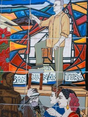 Part of the mural depicts artist Michael O'Kelly painting. His son, who died in 2017 at age 21, and his wife are pictured below.