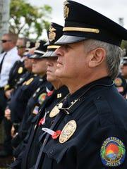 Police Chief Al Schettino stands in the ranks of his