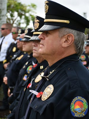 Police Chief Al Schettino stands in the ranks of his officers during a Memorial Day observance at Veterans' Community Park/