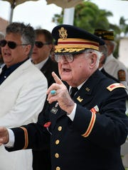 "Herb Savage sings ""God Bless America."" The VFW hosted the Memorial Day observances 11 a.m. Monday, May 28, 2018, at Veterans Community Park on a windblown Marco Island."