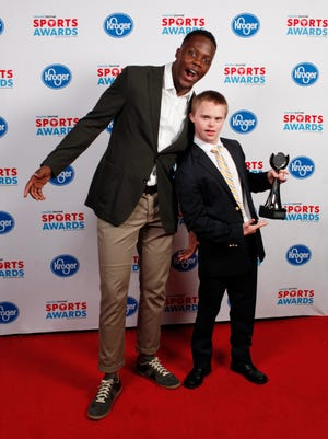 Teddy Bridgewater poses with Aaron Coomes, winner of the Boys Special Olympics Athlete of the Year award, during the 2018 Courier Journal Sports Awards held at The Louisville Palace in downtown Louisville. June 7, 2018