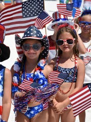 File: Some of the contestants in the Most Patriotic Outfit contest. Marco Island celebrated the Fourth of July with fun and games at Uncle Sam's Sand Jam.
