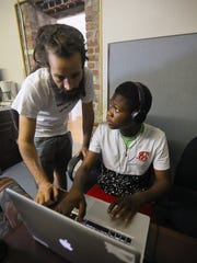 Jared Zarantonello, left, works with Brjay Nyuki, during a Mixing Matters Dj Workshop, run by Rhythm Science Sound, in Louisville, KY. July 9, 2018