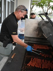 Cpl. Perry Mapes mans the grill. The Collier Sheriff's