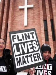 People prepare to participate in a national mile-long march to highlight the push for clean water on Feb. 19, 2016, in Flint, Mich.