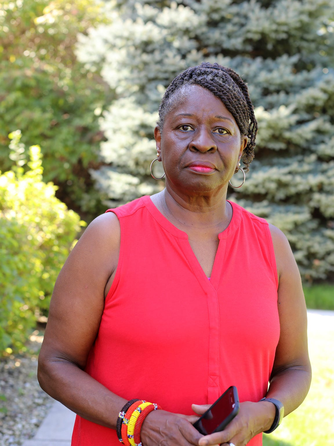 Anita Johnson of Milwaukee helps residents comply with