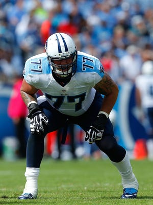 Taylor Lewan of the Tennessee Titans plays against the Jacksonville Jaguars on Oct. 12, 2014, in Nashville, Tennessee.