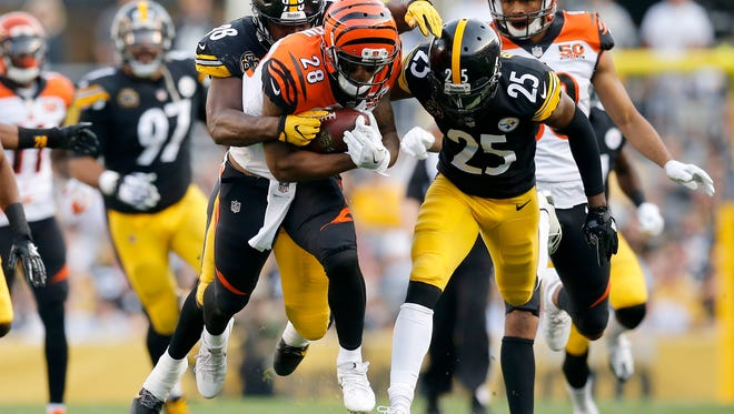 Cincinnati Bengals running back Joe Mixon (28) trucks Pittsburgh Steelers inside linebacker Vince Williams (98) as he brings him down on a carry in the first quarter of the NFL Week 7 game between the Pittsburgh Steelers and the Cincinnati Bengals at Heinz Field in Pittsburgh on Sunday, Oct. 22, 2017.