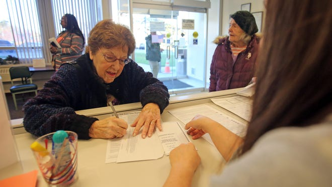 Sue Rudin, 79 of Haverstraw filled out an absentee ballot at the Rockland County Board of Elections in New City on Nov. 7, 2016.