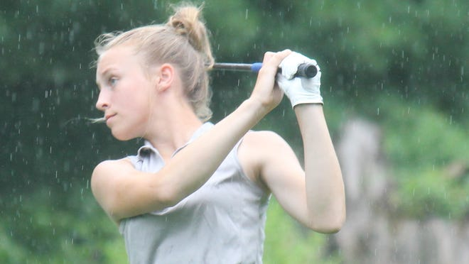 Abigail Retherford of Ravenna won the girls 13 to 15 age division, follows her shot on second hole.