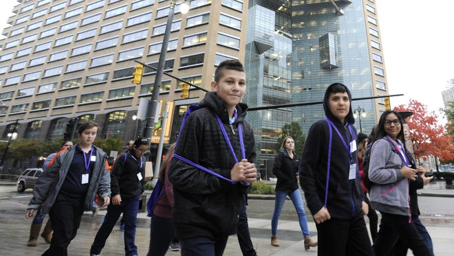 """Quicken Loans' Community Investment Fund's mentoring efforts include the recent """"Day of Innovation,"""" which saw 140 Detroit students touring downtown businesses and trying tech-related projects."""