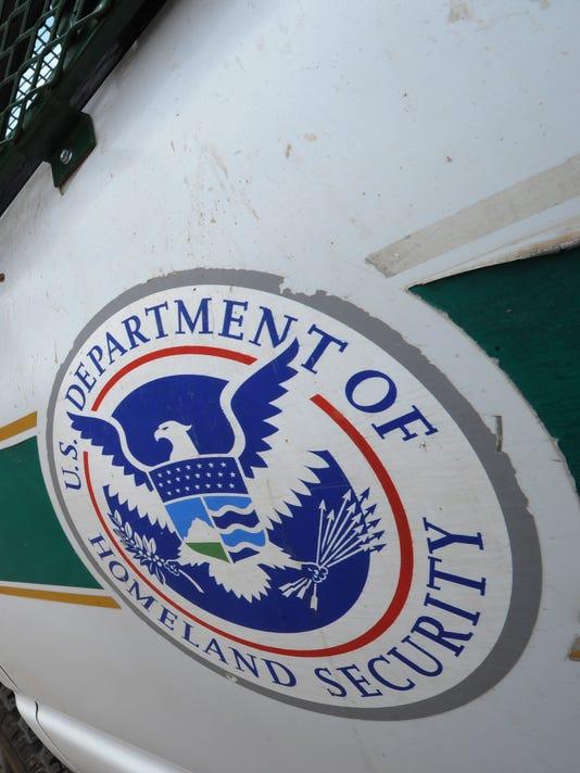 A Border Patrol vehicle keeps watch besi