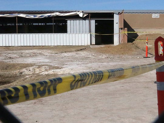 Yellow caution tape surrounds an entrance to a horse stable area along Racetrack Drive at Sunland Park Racetrack and Casino. Racing was halted on Jan. 23.