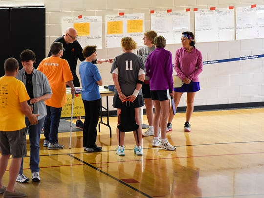 Pickleball players get their court assignments before their matches during the Minnesota Senior Games on Friday, May 20, at the Whitney Recreation Center.