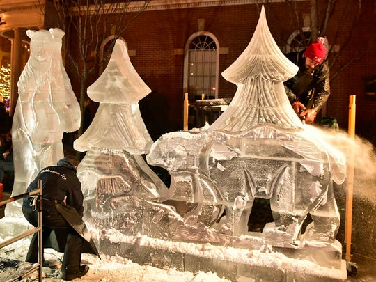 Ice is carved Friday evening during Chambersburg IceFest.