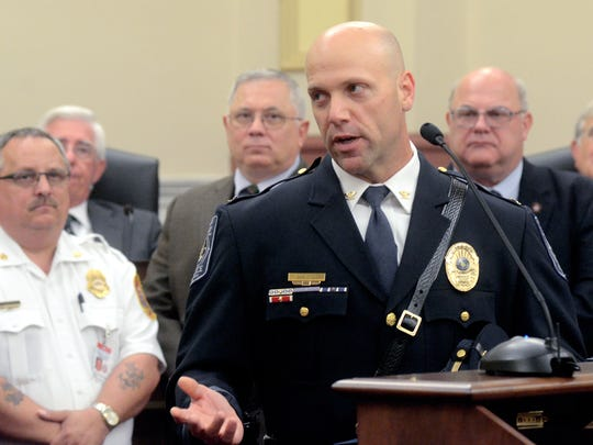Newberry Township Police Chief John Snyder represents the York County Chiefs of Police Association as they are recognized by the York County Commissioners for their service during Tropical Storm Lee, Wednesday October 11, 2011.  York Dispatch File Photo