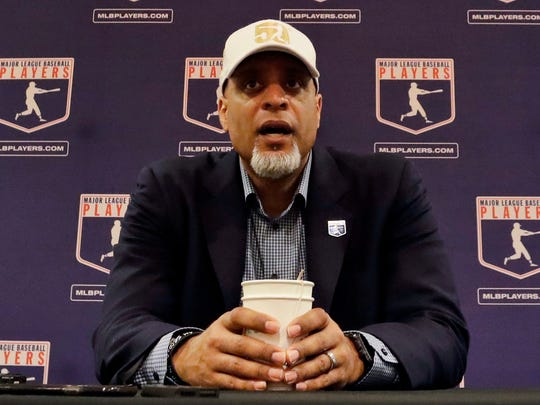 "Tony Clark, executive director of the Major League Players Association, answers questions at a news conference in Phoenix. Clark sadi Tuesday, Feb. 6, 2018, that the number of rebuilding teams and unsigned free agents in a historically slow market ""threatens the very integrity of our game."" Just 53 of 166 players who exercised their free agency rights last November had announced agreements entering Tuesday, down from 99 of 158 at a similar time last year."