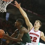Michigan State Spartans guard Eron Harris (14) looks to shoot as Wisconsin Badgers forward Ethan Happ (22) defends during the first half at the Kohl Center.